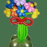 букет из воздушных шаров цветные ромашки с бантом
